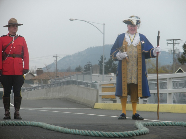 A member of the Royal Canadian Mounted Police and the Sidney town crier welcome WSF's first sailing of the year from Anacortes to Sidney, British Columbia. Photo credit WSDOT.